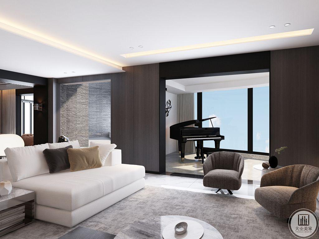 因为女主人酷爱钢琴,因此为她设置了钢琴房,房间外面是一个小客厅,主要是女主人接待朋友、聊天的地方,设计师利用灰色地毯提升整体温暖度,墙上暖色调的LED和钢琴房的落地窗相得益彰,颇为生动。