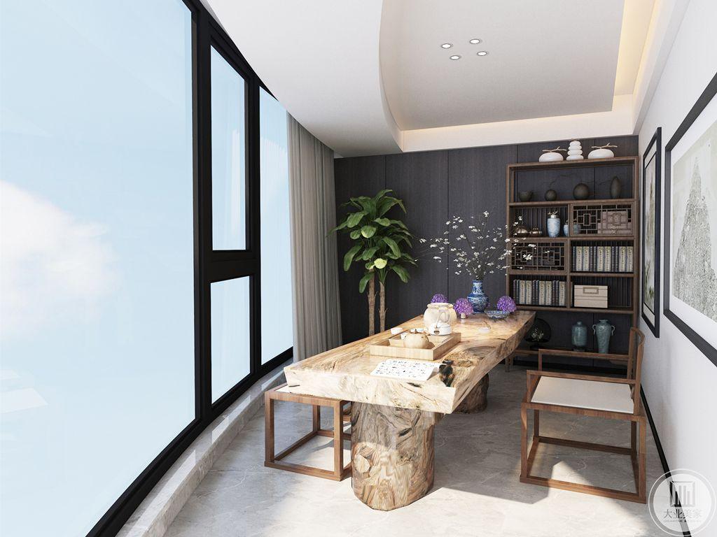 茶室是本案室内面积最小巧的地方,茶桌为质地上乘的原木制作而成,茶室内壁柜和墙贴均为黑色实木,放置的摆件和书籍装订工整,造型别致,使得该茶室小巧而不小气,精致润雅。