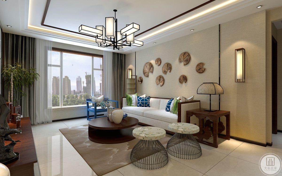 本案客厅和餐厅未分隔,通过简单的几何形体排列组合成灯具、及背景墙装饰品,反映出融合现代精神的独特传统韵味;