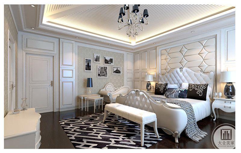本案卧室吊顶造型别致,卧室采用大量护墙板和墙纸挂画搭配,使其浪漫而极富情调,床具和柜子等使用白色调,配合深色实木地板,使其整体充盈而具有美感。