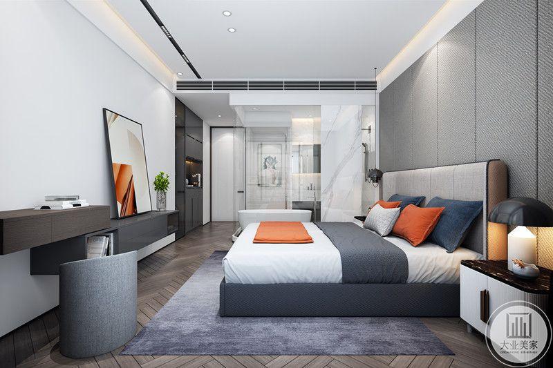 这个卧室的亮点在于色彩的运用,设计师采用白色为主色,利用橘色系点缀空间,地毯、凳子、床具又采用灰色系,整体层次分明,利落华丽。
