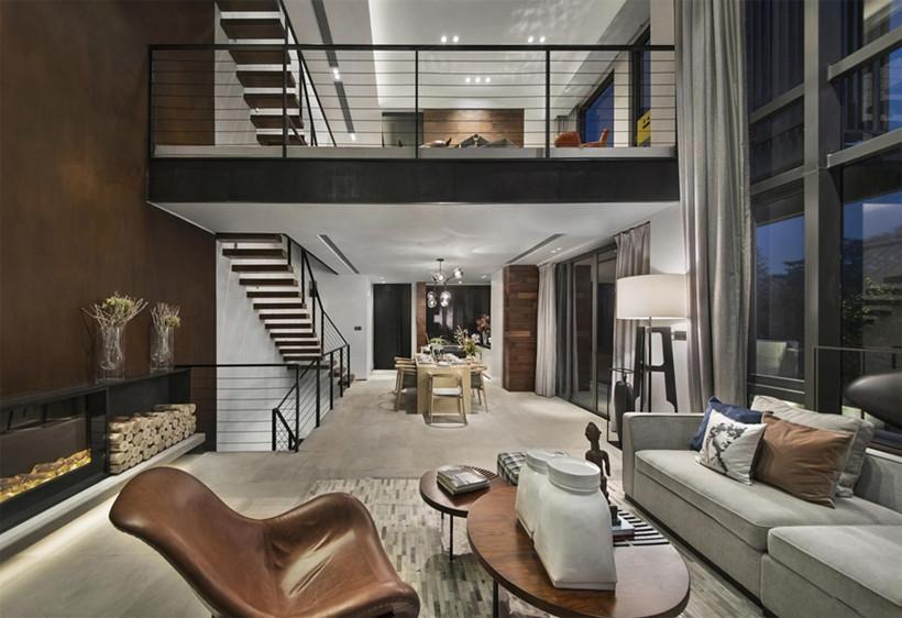 从色彩视觉欣赏,简洁明静的白色成为空间主色调是必然的,温暖细腻的木质色与冷静沉着的大地棕色,能在原材质以及高端进口家私的质感衬托里,利用错乱拼接式的设计手法,为客厅创造出一种时尚简约时尚的美感。